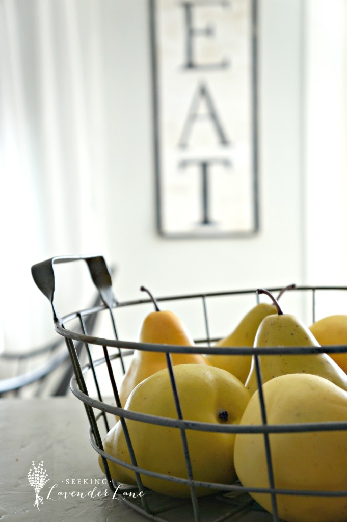 EAT sign and close up pears