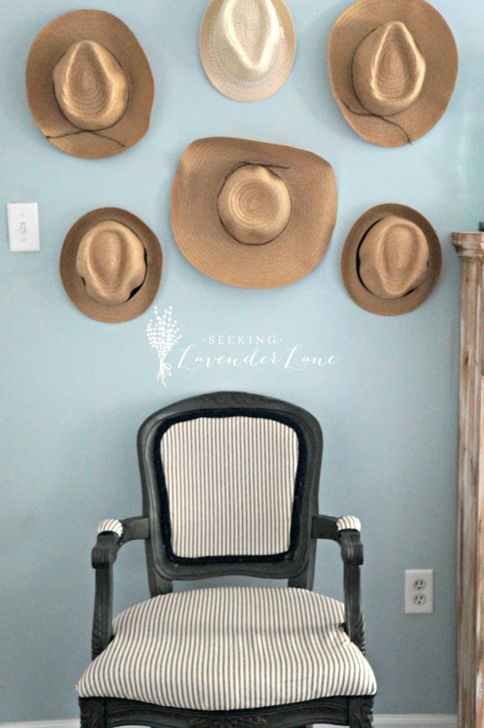 Straw Hat Gallery Wall on Blue Wall