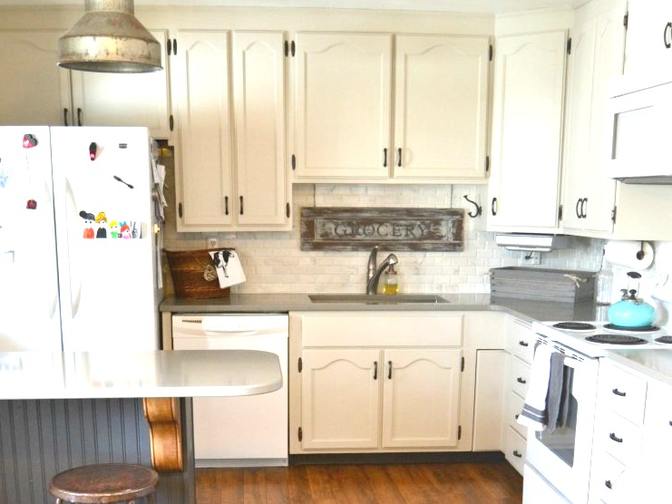 Off white cabinets, brick backsplash farmhouse kitchen