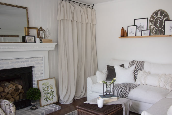 drop cloth curtain to hide a TV