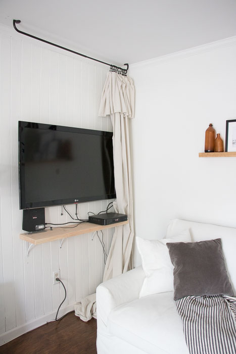Easy way to hide a TV with a drop cloth curtain