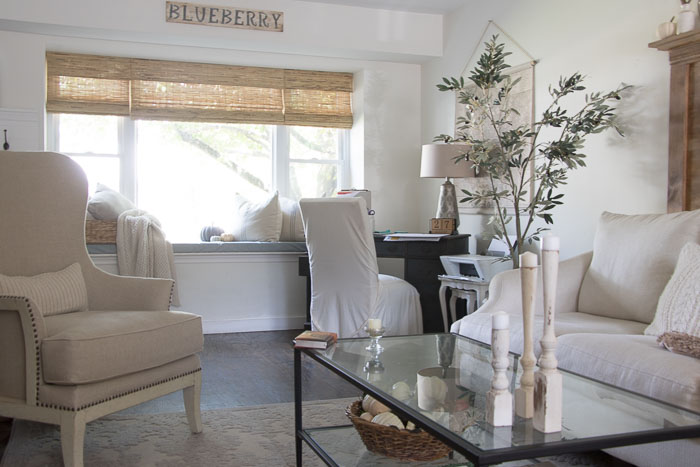 farmhouse living room with bamboo blinds
